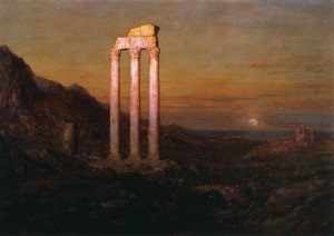 Ruins of an old temple against a landscape at sunset or sunrise