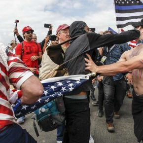 Two men of opposing views fight at political rally