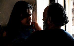"""(Still from """"The Painted House - Chaayam Poosiya Veedu"""" featuring Indian actors Neha Mahajan and K. Kaladharan)"""