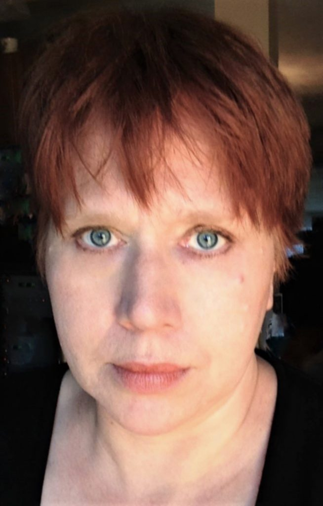 Middle aged white woman with red hair, headshot