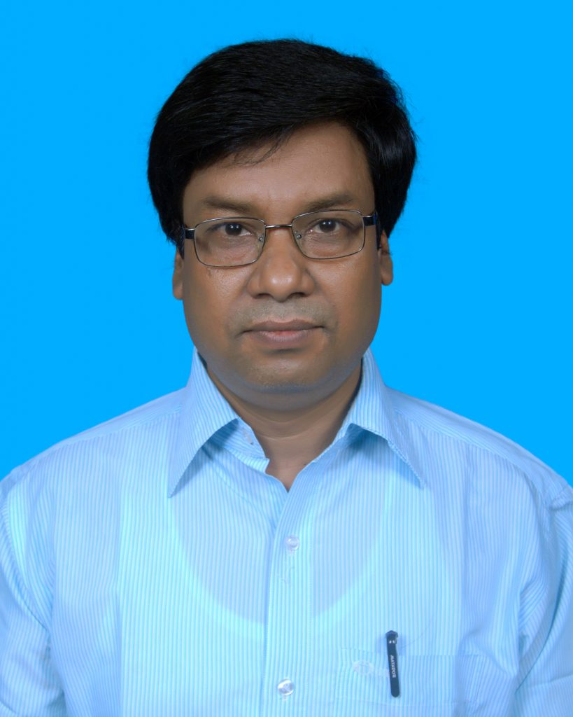 Author Mahbub, South Asian man with brown hair and reading glasses, wearing a white collared shirt.