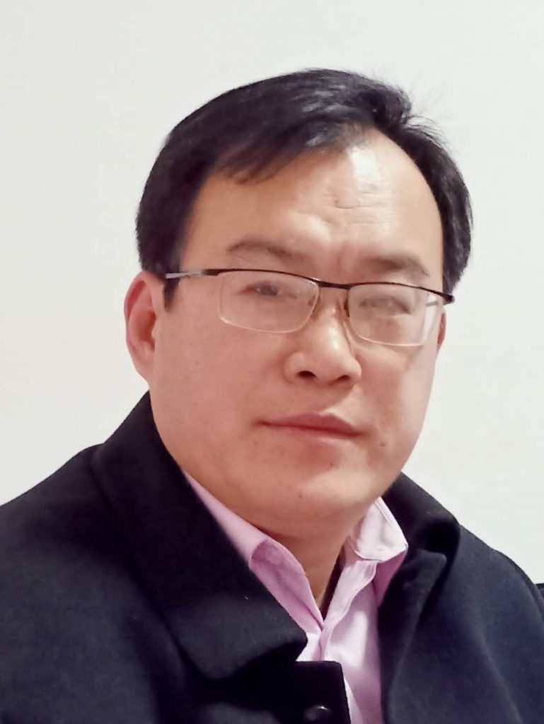 Headshot of a middle aged Asian man with glasses.