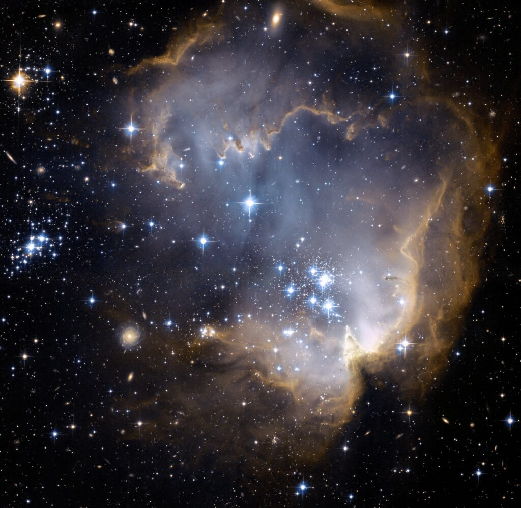 Dust, gas and stars against the black night sky.
