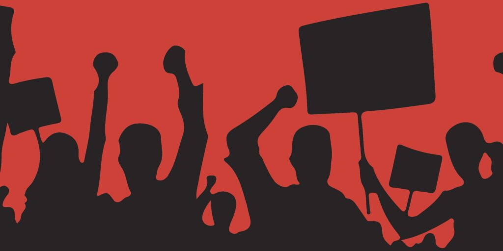 Various silhouetted people raise fists and march with signs.