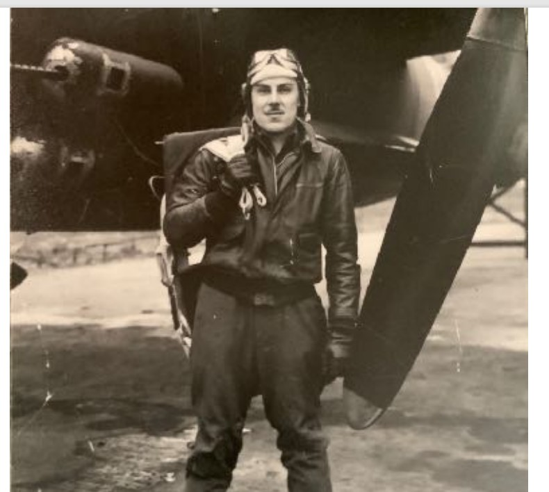 The author's father in his flying jacket in front of his plane.