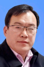 Chinese man with a suit and pink shirt, reading glasses and short black hair.